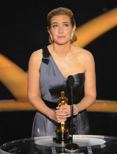 3126606051-british-actress-kate-winslet-accepts-oscar-best-actress-work-reader