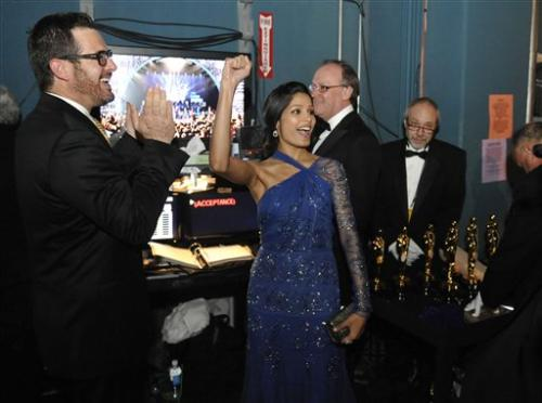 3781378082-actress-freida-pinto-center-reacts-backstage-r-rahman-wins-oscar